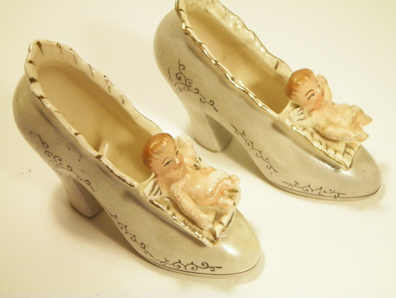 ceramic pair cherub high heel shoe planters by pioneer mose