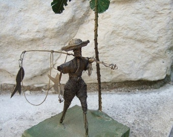 Charming Figural Fisherman Statue from Barbados