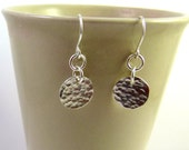Small hammered silver disc earrings.