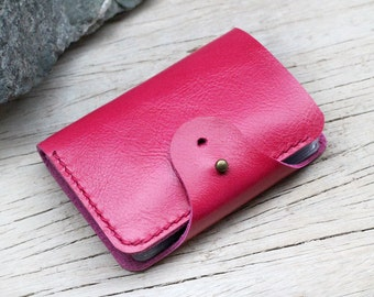 Pink leather card case with bill pocket