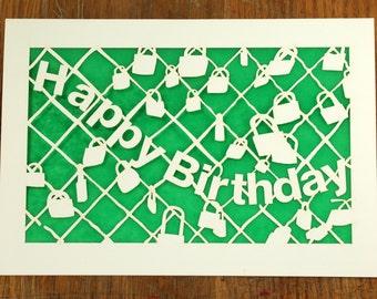 Happy Birthday with Bike Locks on a fence, laser cut card