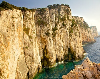 Beach decor, rocks, blue sea, lighthouse island coast in the sunset, beautiful, calm paradise island, Greece, turquoise blue Mediterranean
