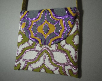 Messenger Bag, Handmade from Designer Fabrics with a Colorful Woven Pattern bordered with Embroidered Metallic Threads and a round Flap.