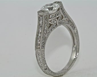 14kt White Gold and Diamond Art Deco Design Engagement RIng with a 1ct White Sapphire Center