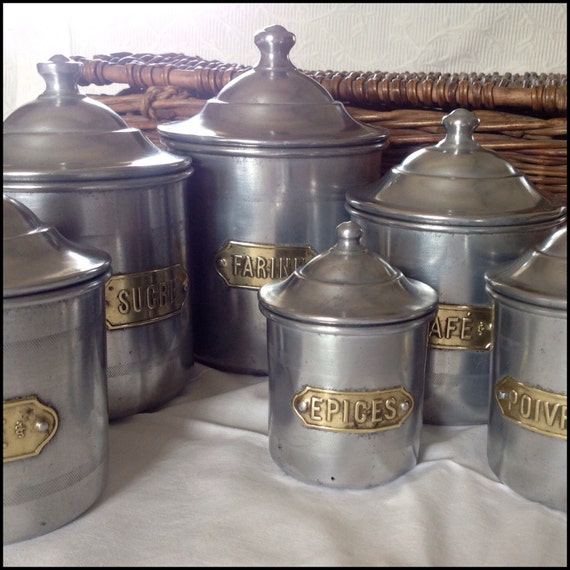 Vintage set of 6 metal kitchen canisters with brass name for Kitchen set name