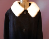 Vintage woman's black wool winter coat with white fur collar made by Burlington Woolen