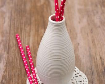 15 fucsia paper straws with small white polka dots