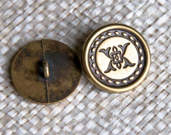 """6 Vintage 7/8"""" Metal Shank Buttons. Brass Tone and Black. Central Geometric Design surrounded by a Stitched Circle. Solid Metal. Item 1213M"""
