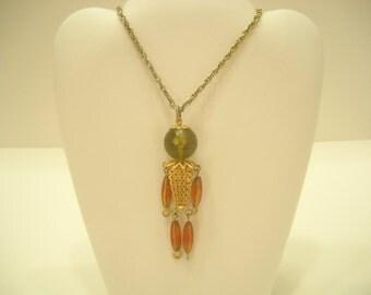 Vintage 1960s PLASTIC PERSON PENDANT (734) Necklace