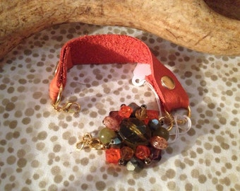 UpCycled vintage orange leather with gold accents