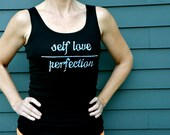 Self Love over Perfection done in vintage looking silk screen on a black workout tank top with a plain back