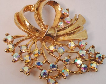 Vintage brooch pin bright Aurora Borealis AB rhinestone set in gold tone costume jewelry Astronaut Wives Mad Men