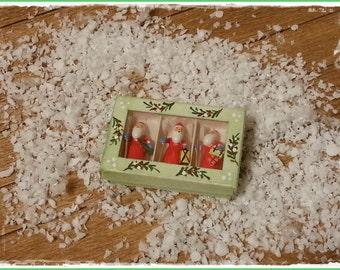 Christmas box with santa clauses
