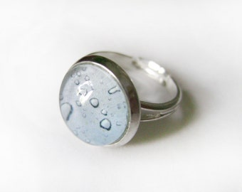 Ring  Blue rain drops . The ring is adjustable .  Ring in blue tones . Rain . Drops .