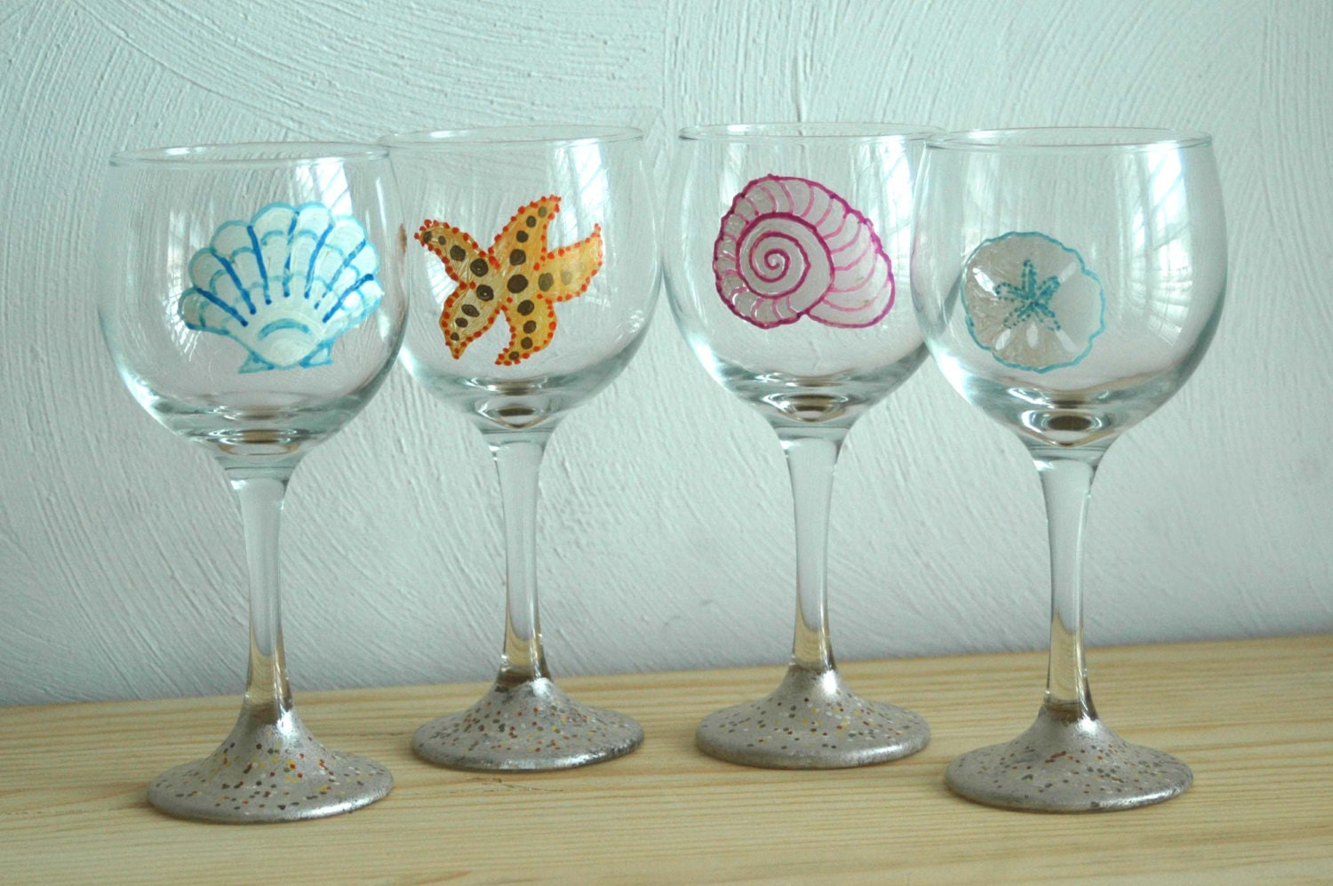 Hand painted beach wine glasses with seashells a sand dollar for Hand painted glassware