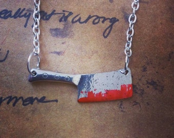 sweeny todd inspired bloodied meat clever necklace