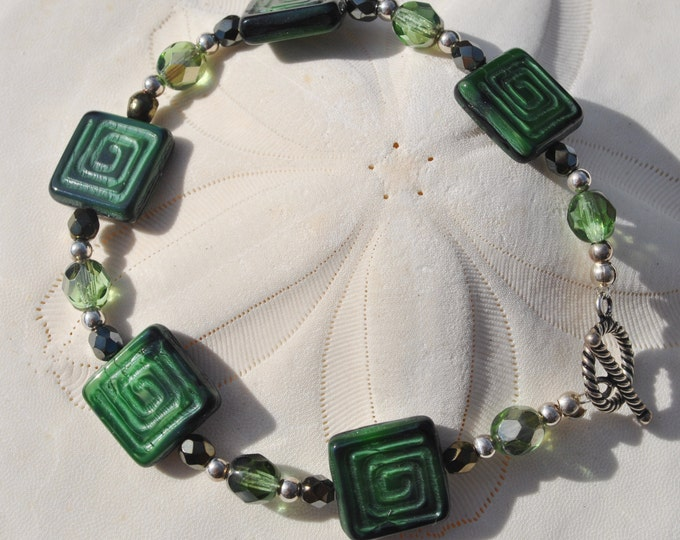 Forest green square Czech glass bead Bracelet Set with green and metallic crystals, sterling silver beads and toggle clasp.