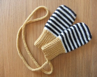 Hand knitted mustard, black and cream stripey baby mittens with knitted string -  sizes 0-3, 3-6, 6-12 and 12-24  months