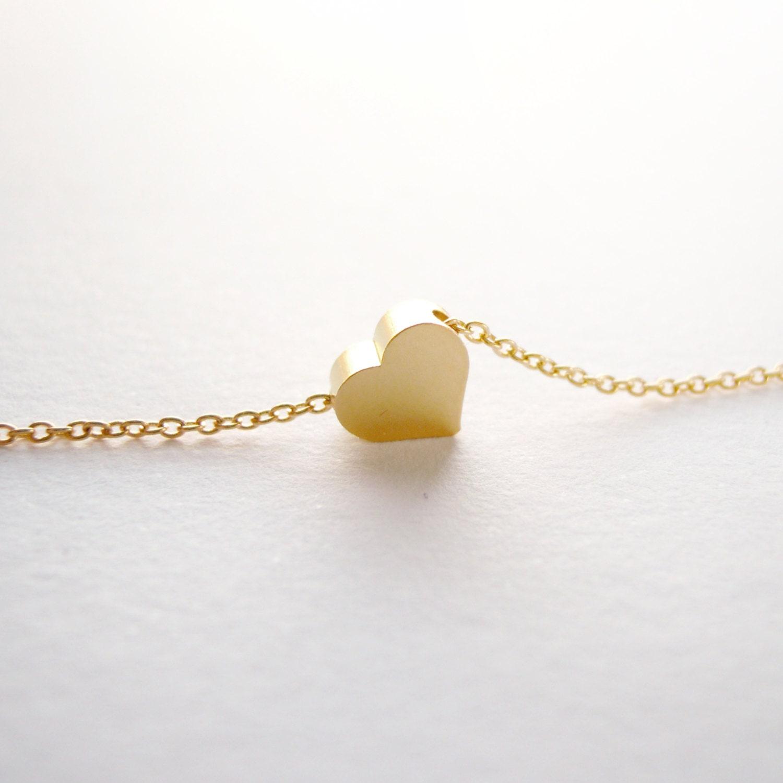 Delicate gold heart bracelet by JoliJoliJewelry on Etsy
