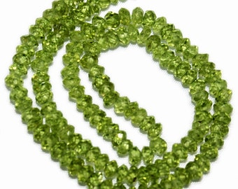 Peridot micro-faceted rondelles, natural, AAA grade.  Approx. 3.5mm.   (1 inch mini strand)