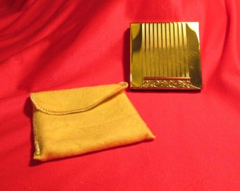 Vintage RETRO gold tone AVON COMPACT unused in original carrying bag