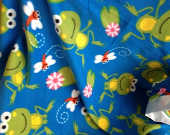Frog print in a fleece with satin binding