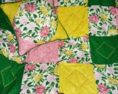 "Spring Lilies...Caring Quilt Set...includes a lap-sized quilt 44"" by 52"", hand-tied and machine-embroidered, plus matching 14"" x 14"" pillow."