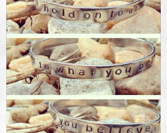 "Mumford & Sons hand stamped aluminum bracelet ""hold on to what you believe"""