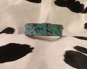 Distressed turquoise dog collar with floral silver spots.