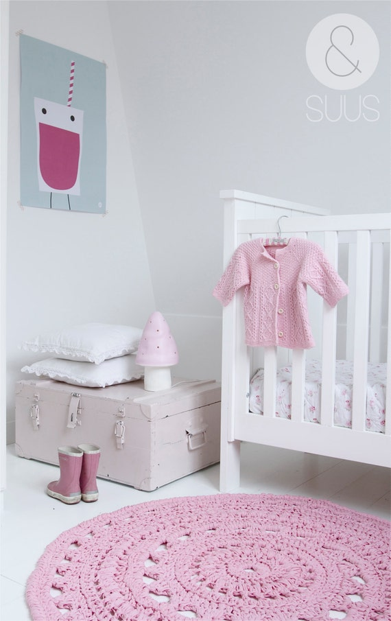 Nursery with pink crochet rug