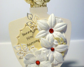 """Card shaped perfume bottle """"white flowers and red rhinestones"""""""