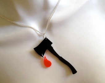 Dramatic black perspex axe..with a dangling drop of blood!..necklace