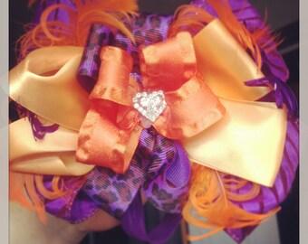 Purple, orange and peach feather bow
