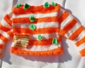 Smiling Shamrock Baby Cardigan - handknitted orange white and green sweater for toddlers with applications and a stripy pocket - koticzka