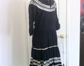 Vintage patio dress . Black gauze with silver Rick rack trim missing the belt