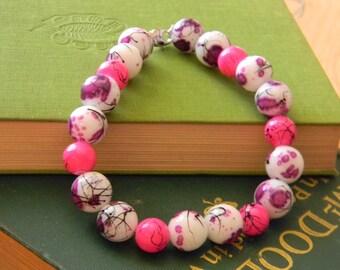 Black Splattered Purple Spotted Glass and Black Splattered Hot Pink Bracelet