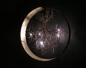 Handmade ceiling light made of pewter wires.