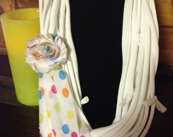 Necklace, t-shirt, white with chiffon polka dot flowerette with streamers.