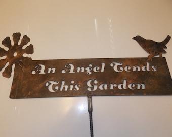 An Angel Tends This Garden metal sign