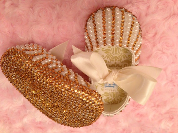 Gold rhinestones with cream colored pearls all over embellishment of Ballet shoe