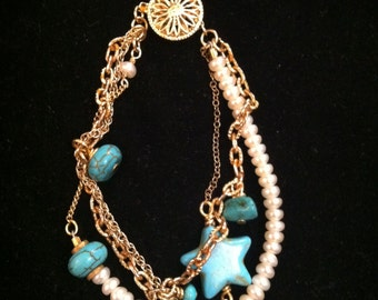 Triple gold with turquoise
