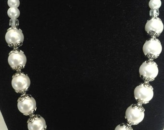 Cosmetic pearl set back view available this set consist of  necklace, earrings, and bracelet.
