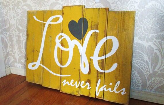 Items similar to Large Love Never Fails Mustard Yellow ...
