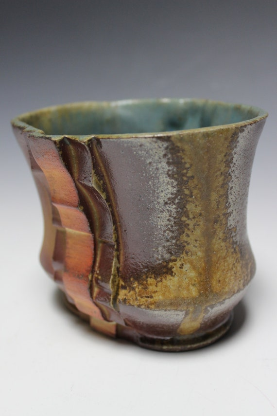 Handmade ceramic cup blue flashing orange wood fired woodsy