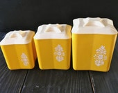6-piece Yellow Plastic Canister Set with White Flower Decal