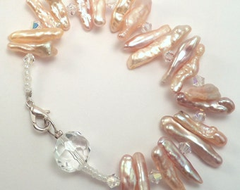 Stick Pearl Bracelet with Swarovski Crystals and a sterling silver finish clasp.