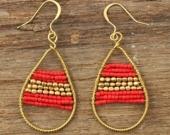 Brass tribal hoop earrings in red with brass beads in the centre