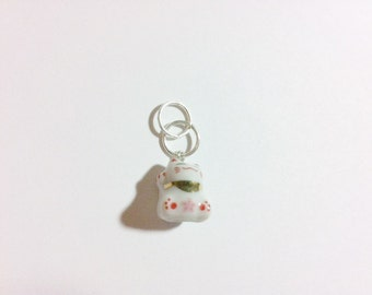 Small porcelain cat charm