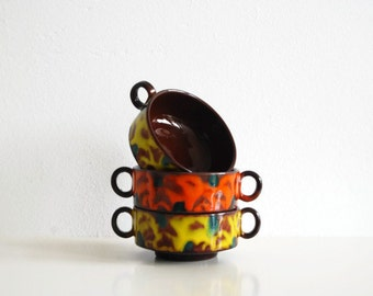 Vintage dishes with ears. Colorful snack dishes.