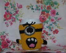 Knitted minion cup cosy